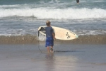 Hunter going out to surf